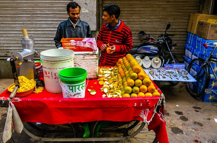Ever seen a street vendor who sells oranges AND necklaces?