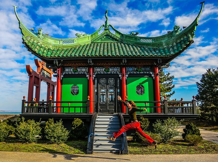 Jumping for joy at the Chinese Tea House of the Marble House Mansion in Newport.