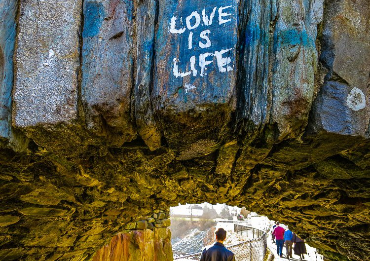 Graffiti on a tunnel in the Cliff Walk behind the mansions. Is Love life, or is Money?