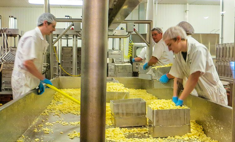 Packing the cheddar. Squish, squish!