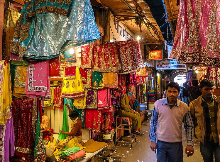 An alley in Jaipur selling stunningly colored clothing.