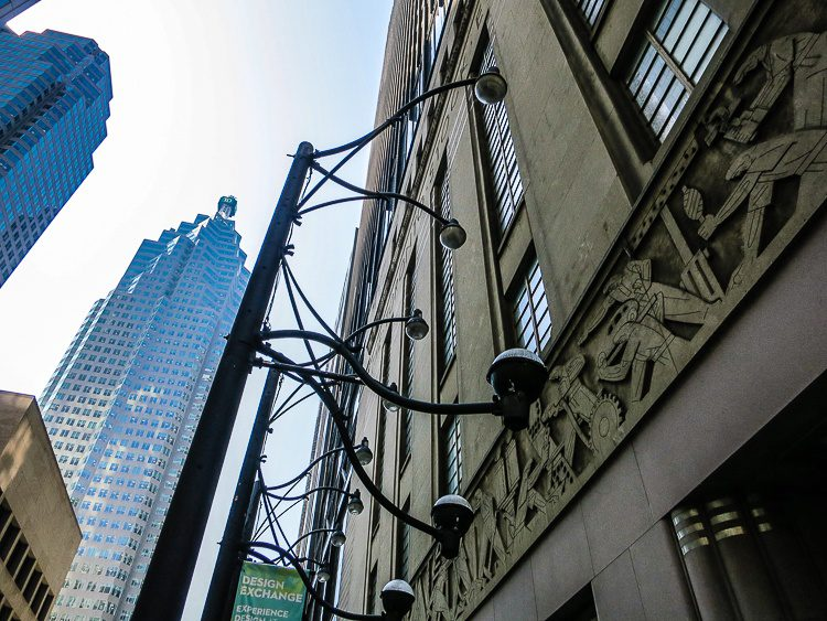 The old Toronto Stock Exchange smiles at the new glass buildings.