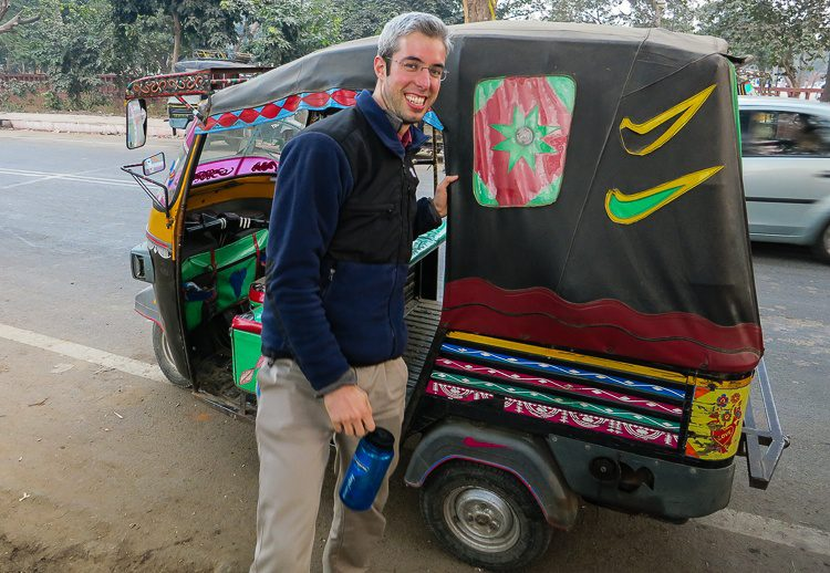 """My 6'6"""" brother fitting in a tiny (Nike brand?!) tuk tuk."""