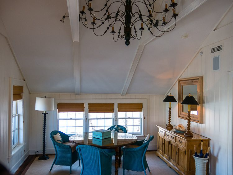 The cottage's dining room, replete with an ornate chandelier.