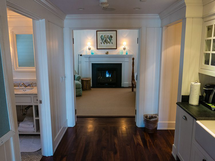 The hallway of our cottage, displaying the fireplace in the bedroom!