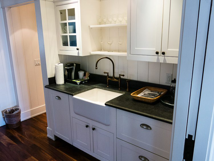 The kitchen area has a mini microwave, drawer fridge and freezer, and... mini-dishwasher?!