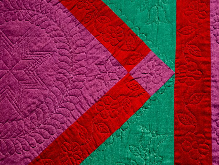 Check out the intricate stitching decorations on this quilt.