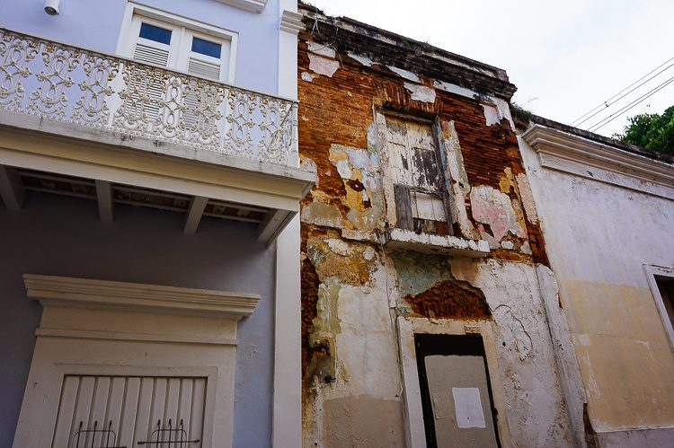 Old San Juan: A perfectly preserved building next to a decrepit one. Why?