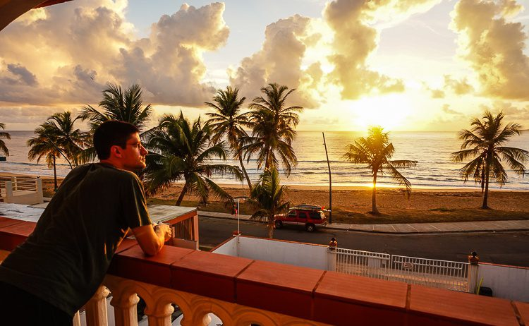 Colin admiring the sunrise from our balcony.