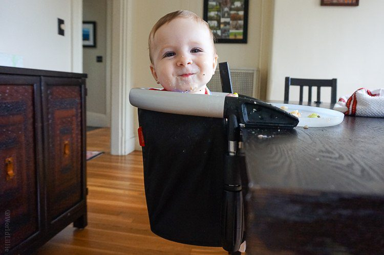 A travel highchair like The Lobster hooks to a table.