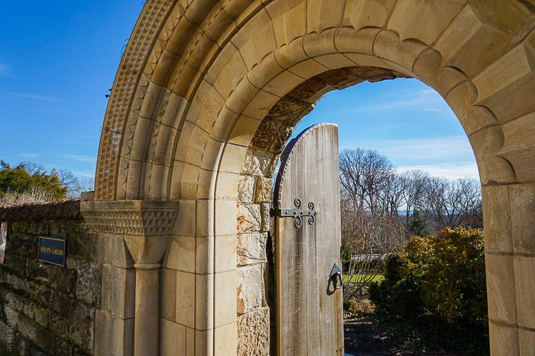 """This magical door outside the cathedral leads to the """"Bishop's Garden."""""""