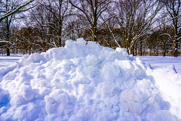 One of many massive piles of plowed snow in Boston.
