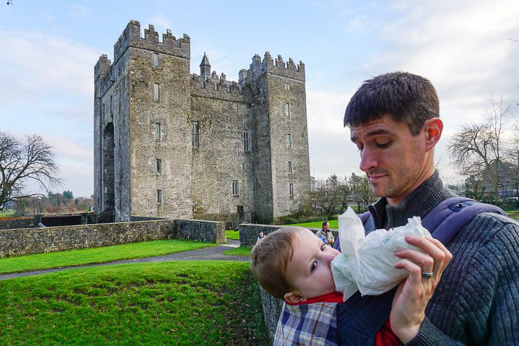 Parent life: At a castle in Ireland, feeding baby from a broken milk bottle wrapped in a diaper to catch the spills.