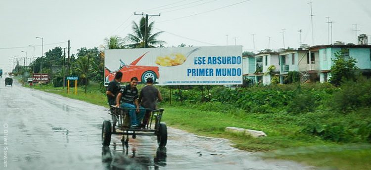 """This buggy in front of a """"That absurd First World"""" billboard sums up Cuba's current situation to me."""