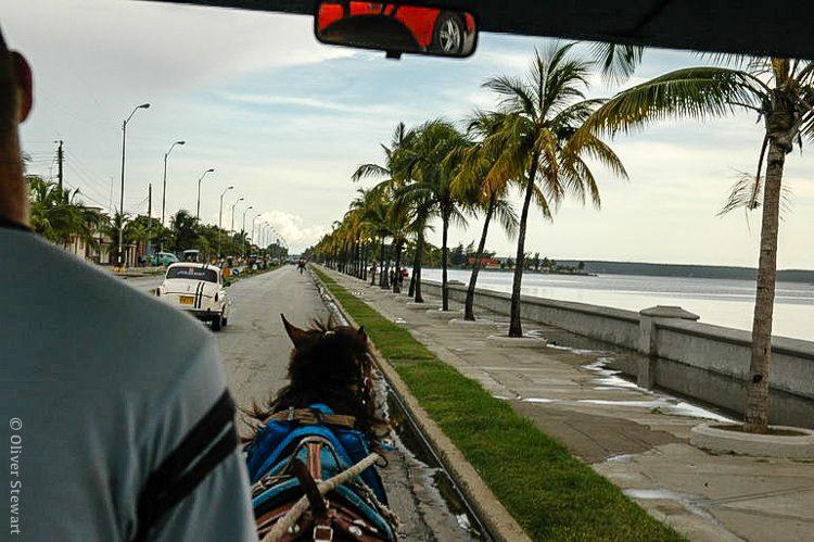 Riding a horse taxi through Cienfuegos.