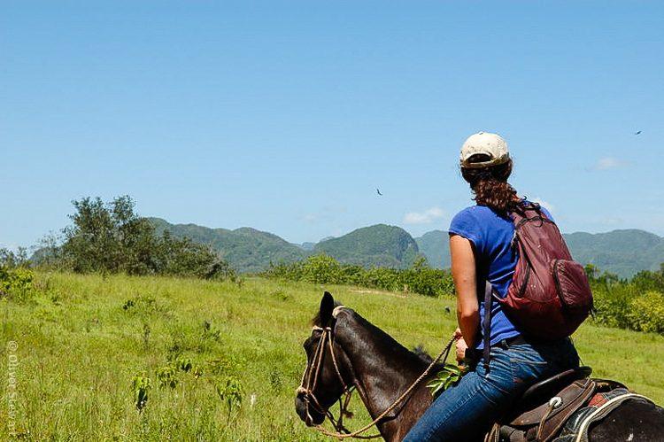 Me during our horseback tour of the lush green expanse of Viñales, Cuba.