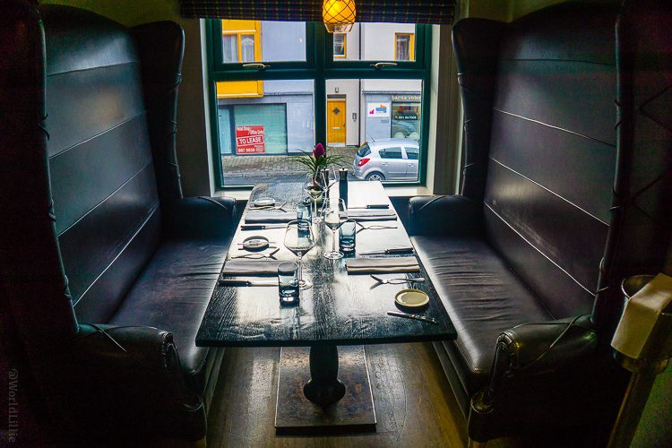 Check this out: In the restaurant Upstairs at West, these seats can face each other...