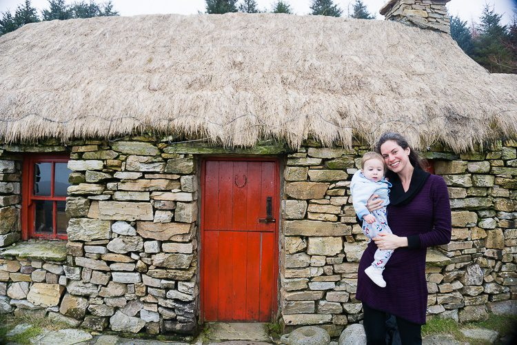 Snuggly in my sweater dress with baby at the Dan O'Hara Homestead in Connemara, Ireland.