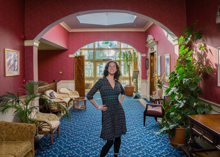 Rockin' the Perfect Wrap dress in a classy Ireland hotel lobby.