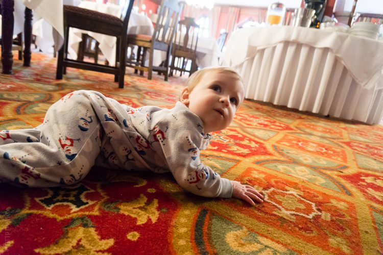 Baby Devi was entranced by the patterned carpet.