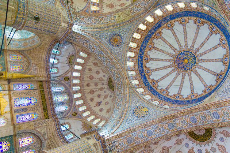 Looking right up at the mosque's domed ceiling.
