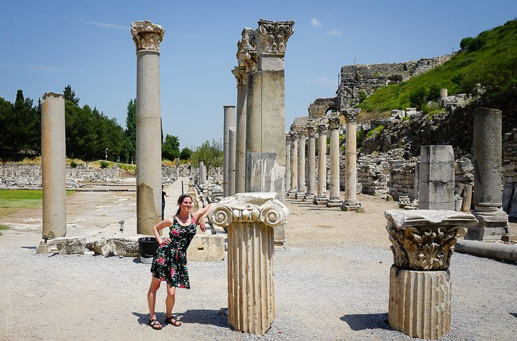 A dark dress stands out against the famed ancient ruins of Ephesus.