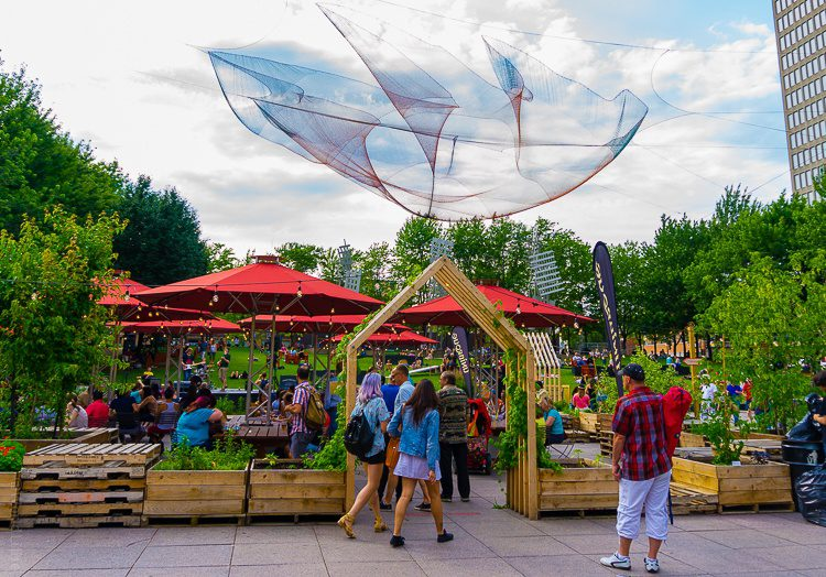 An outdoor eatery, park, and art installation near The Village.
