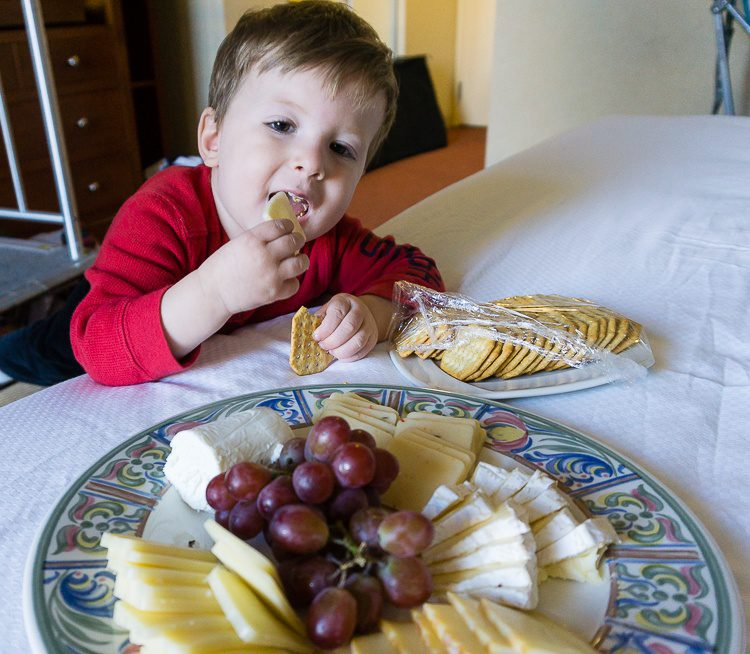 Scarfing the fancy cheese plate left by our Southbridge Hotel!