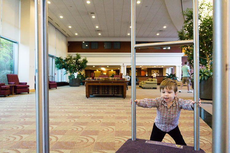 Devi enjoyed pushing the luggage cart around the soaring lobby.