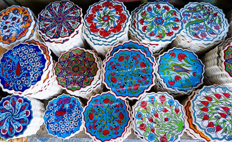 These turquoise coasters or hot plates would brighten any dining room.