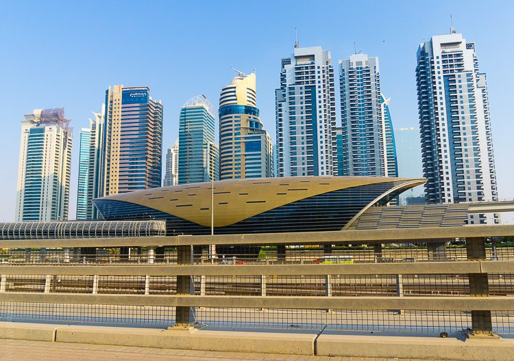 Dubai is known for its luxury skyscrapers, framed here by a Metro station.