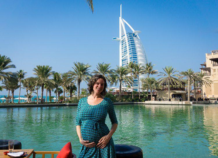 Pregnantly enjoying the iconic Dubai view of the Burj Al Arab building.