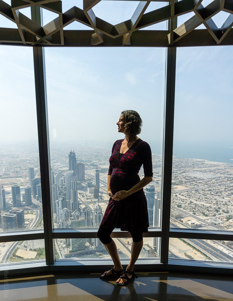 Maternity dresses: Atop the world's tallest building, the Burj Khalifa in Dubai. This is a non-maternity Perfect Wrap and you can see it still fits a bump.