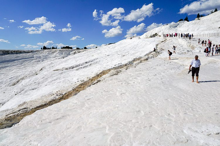 People from all over the world come to climb down Pamukkale.