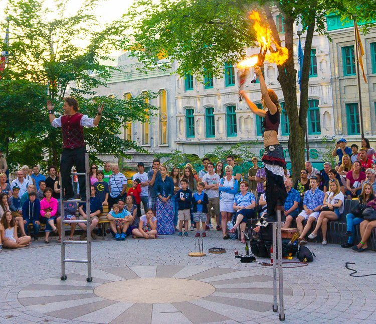 Fire-juggling street performers.