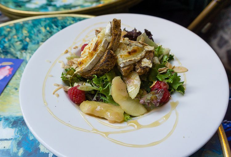 Salad with brie, raspberries, and honey.