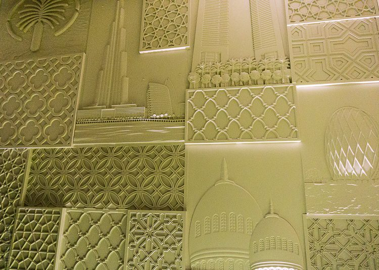 The walls show achievements from all seven emirates. See the Burj Khalifa, the tallest building in the world?