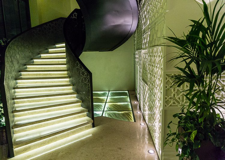Behind the spiral staircase, the glass floor has sands from all seven emirates.