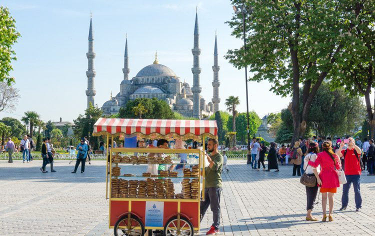 A man selling simit (like a Turkish bagel) outside the Blue Mosque.