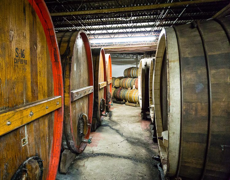 Giant barrels of wine aging at Wagner Vineyards.