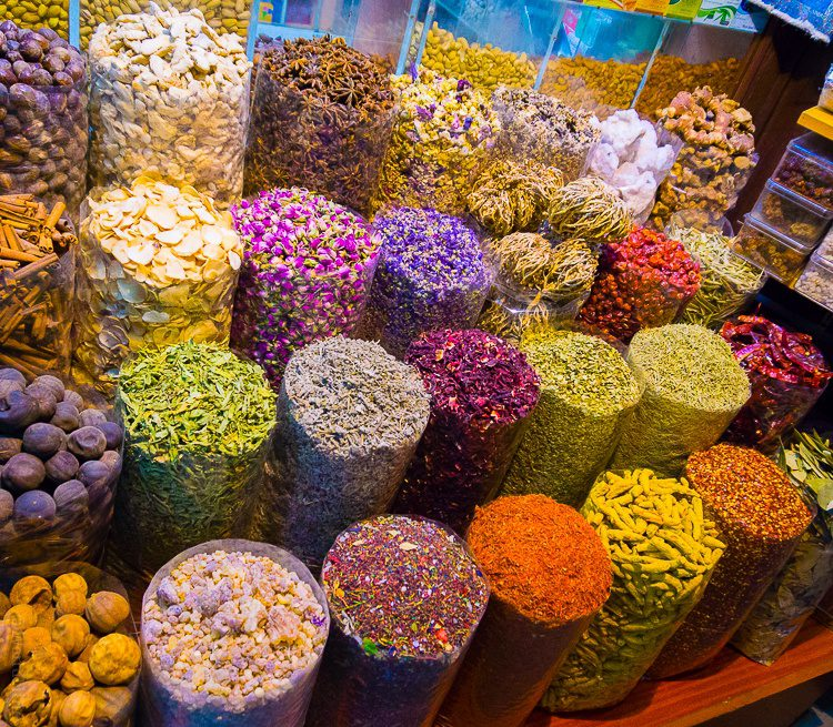 Rainbow colored spices in Dubai's Spice Souk.
