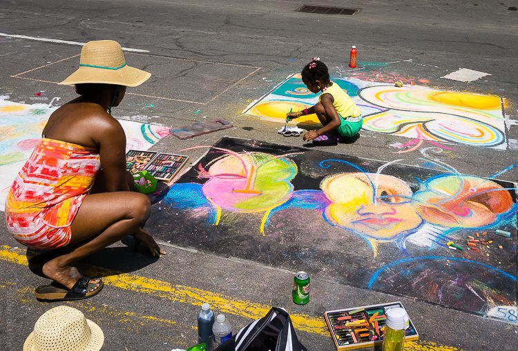 Mother and daughter street painting.