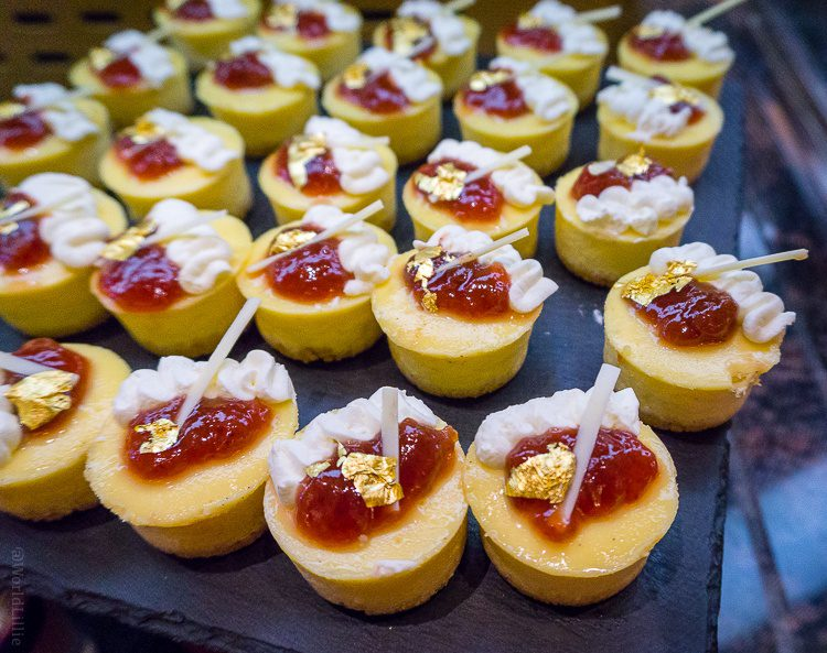 Mini cheesecakes with GOLD FOIL in the dessert buffet.