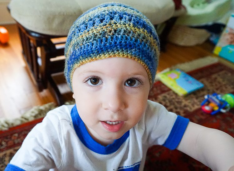 Our toddler modeling the hat his Daddy crocheted.