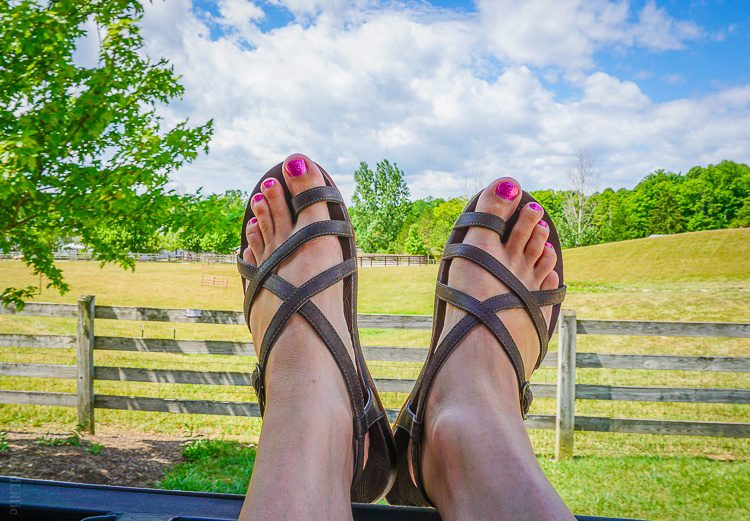 Showing off my Dorra sandals out the back window of a tractor ride at the Ohio farm.