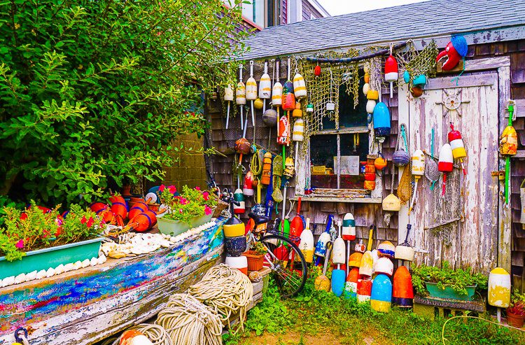 Colorful buoy-decorated houses line the waterfront.