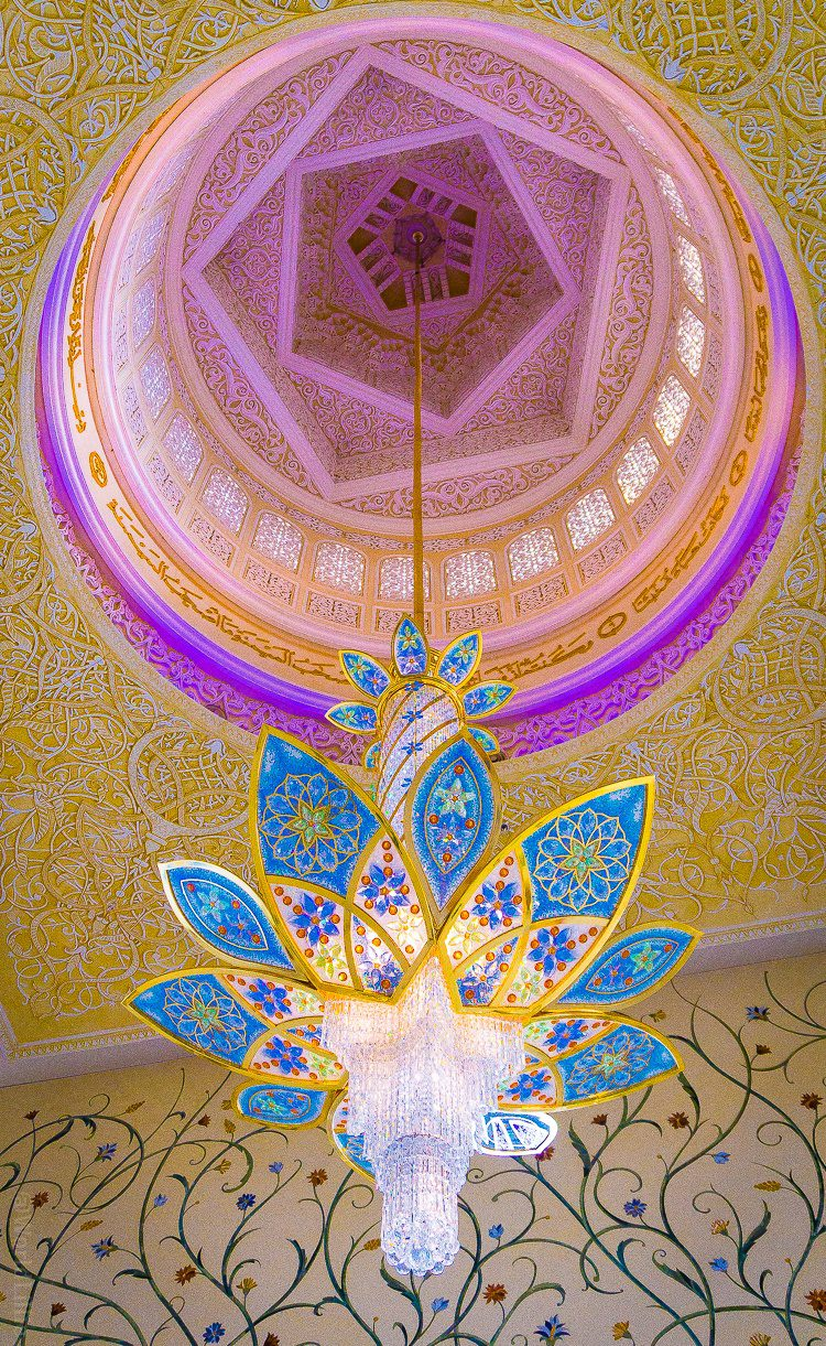 Geometric shapes in the chandelier and ceiling! The Sheikh Zayed Grand Mosque in Abu Dhabi, UAE is one of the most beautiful free tourist attractions in the world. Learn tips on visiting this amazing building.