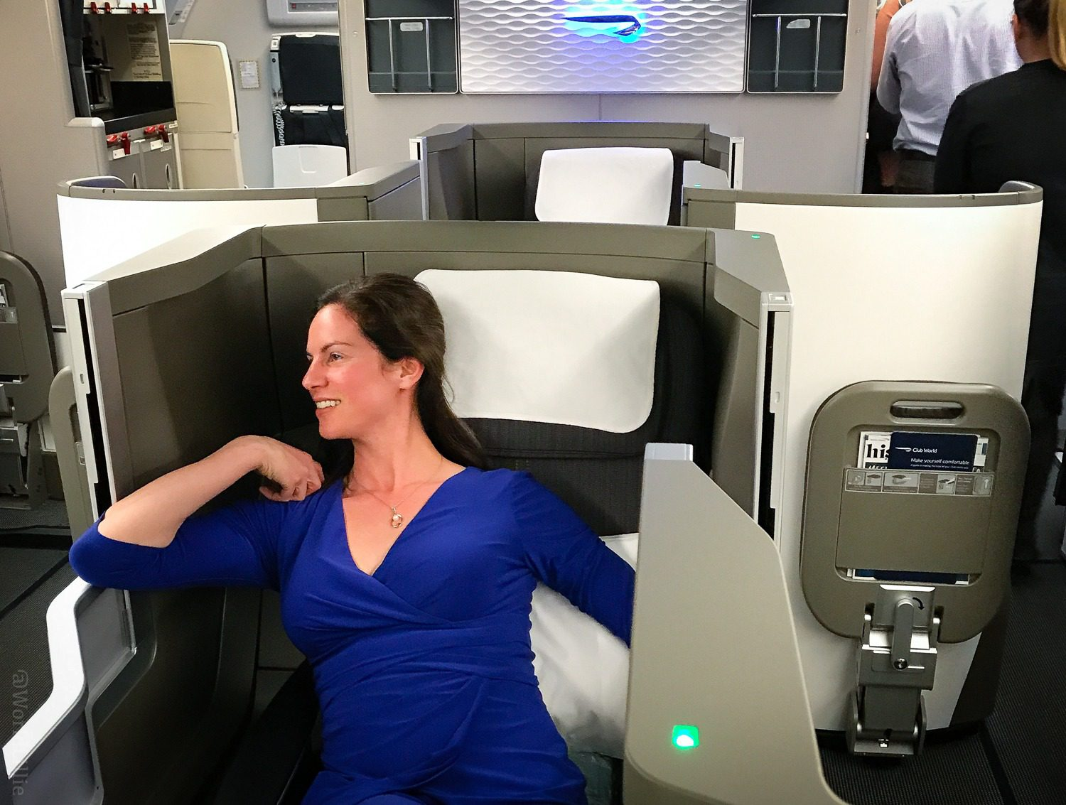 Fully reclining airplane seats and privacy walls?! Yes!
