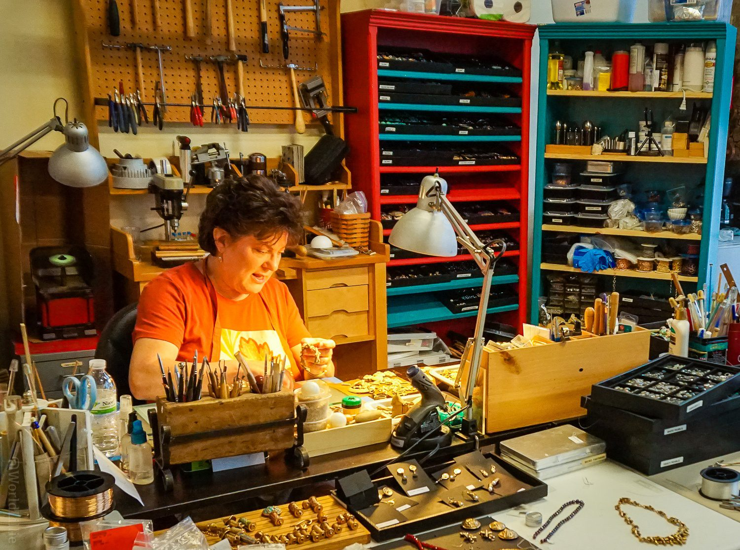 An artist hard at work on metal clay jewelry.