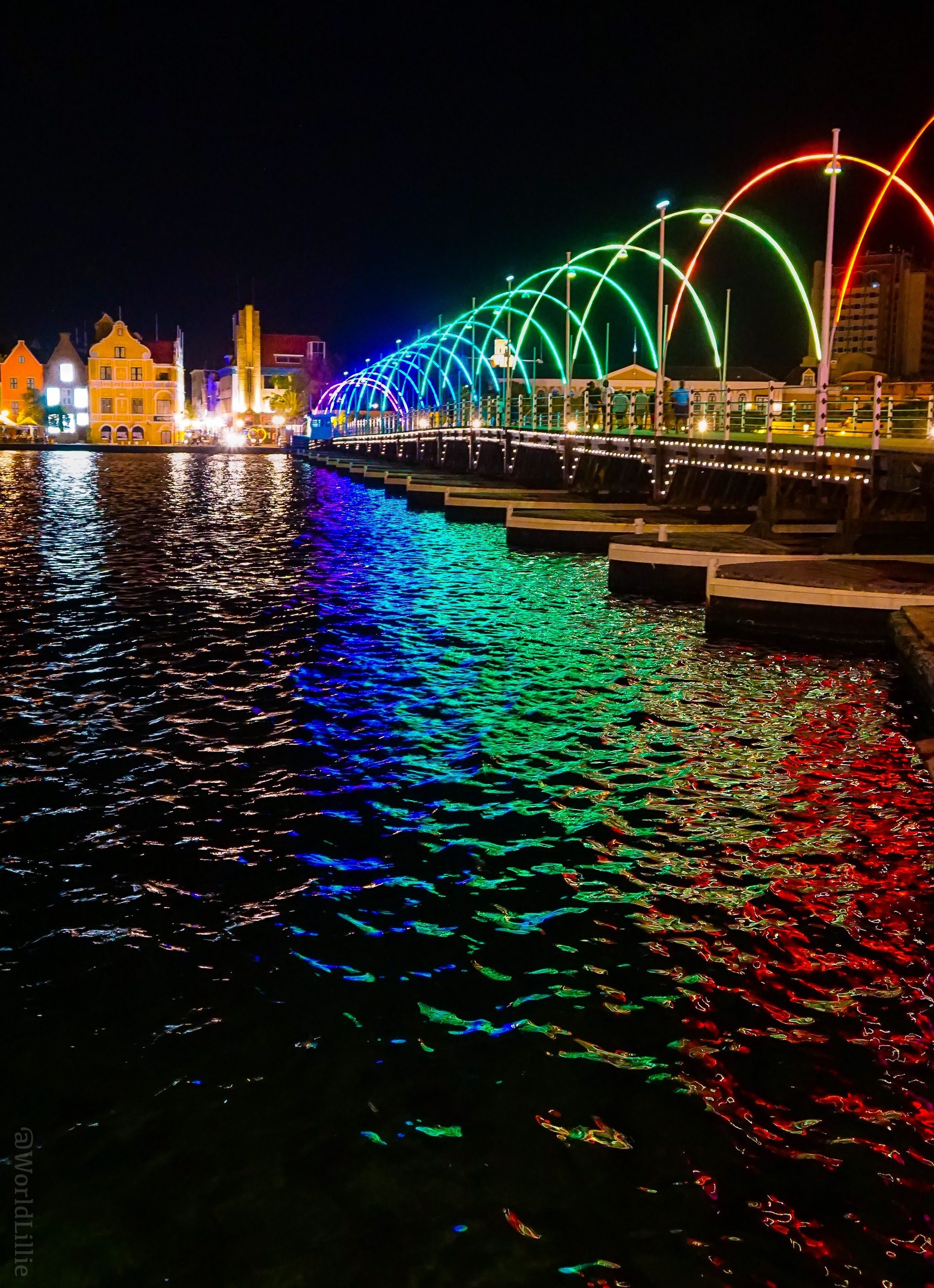 The Queen Emma Floating Bridge in Willemstad, Curacao, is a gorgeous floating rainbow!